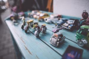 Toy Cars and Motor Bikes in three rows